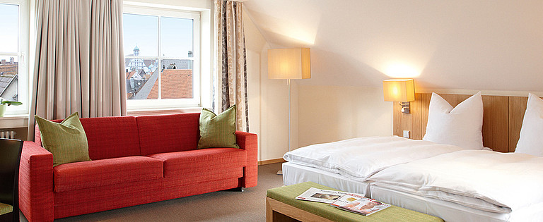 Stylish rooms for two at the centrally located four-star Hotel Falken
